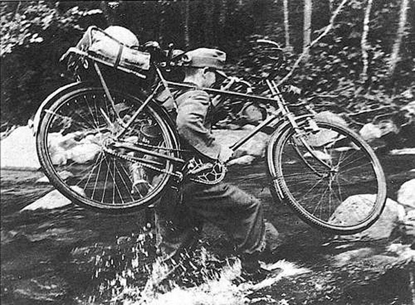 Gebirgsjaeger advances along a stream in Norway1940