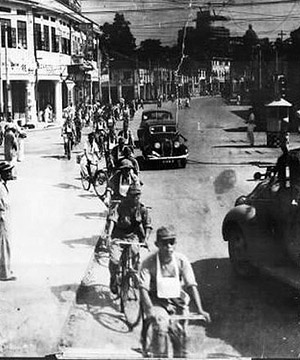 Japanese troops riding into Singapore, 1942
