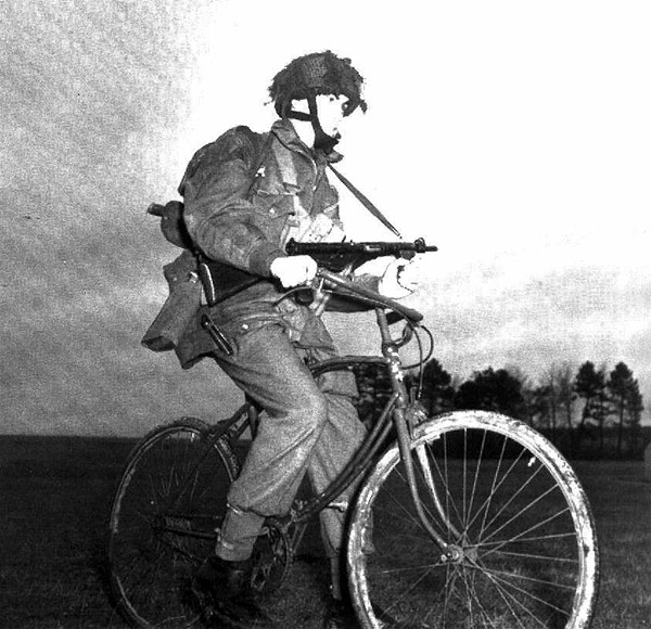 Private of 1 Canadian Parachute battalion posed on a BSA airborne bicycle at their reinforcement camp in England 1944